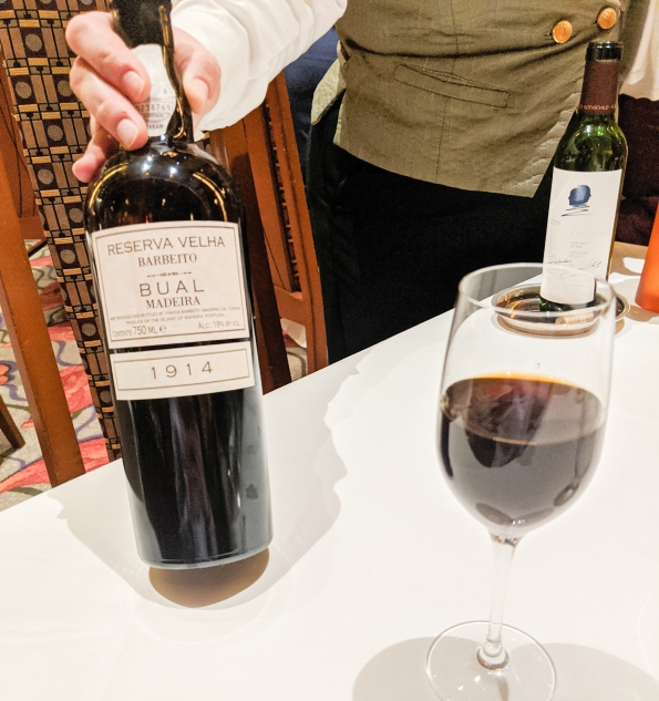 A bottle of 1914 Madeira wine being served